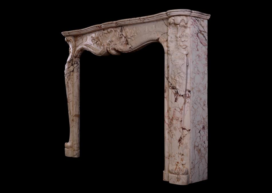 A Louis XV antique fireplace in a variegated marble