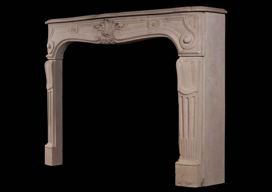 A French Louis XV antique stone fireplace