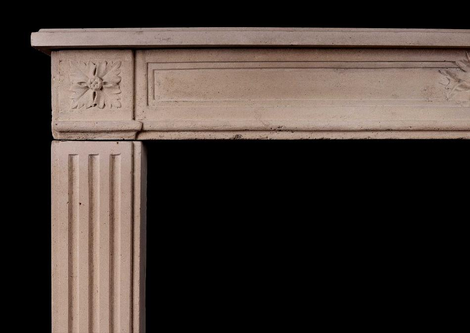 A French Louis XVI Style carved limestone fireplace