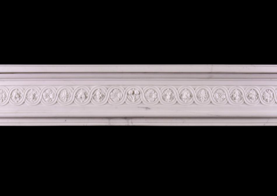 A carved French fireplace with guilloche frieze