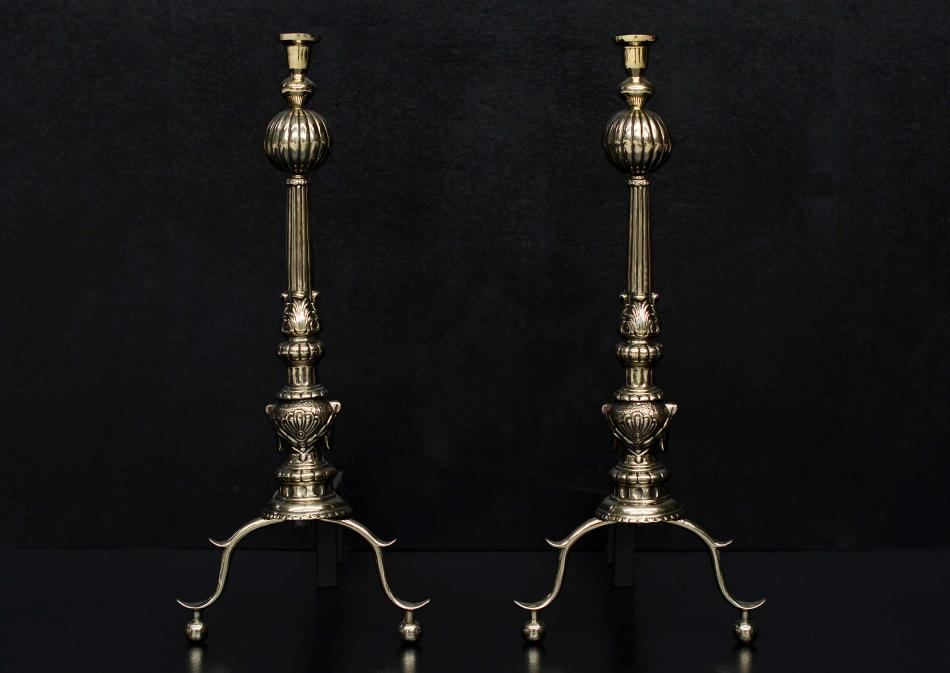A pair of English brass firedogs with gadrooned finials