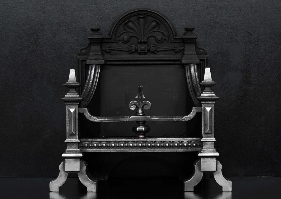 A polished cast iron firebasket in the Gothic style