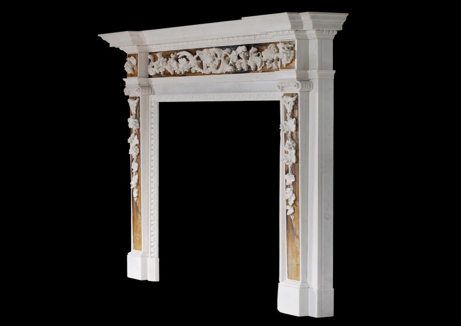 An English George II white marble fireplace with Siena inlay