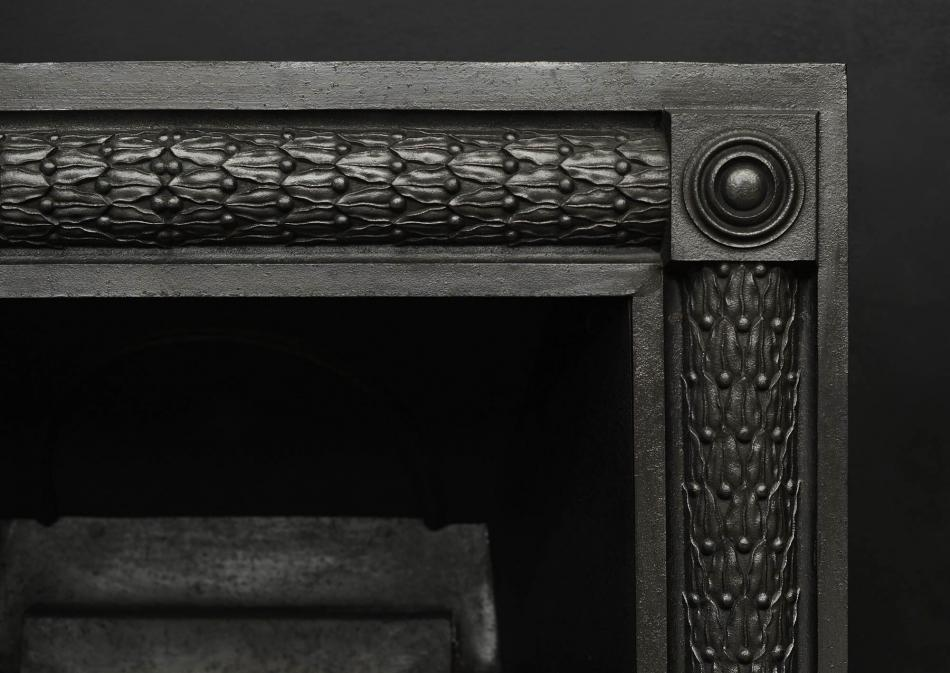 A cast iron register grate in the late Georgian style