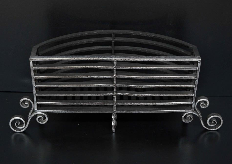 A polished Arts and Crafts wrought iron firegrate