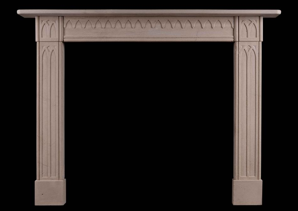 A late Georgian English limestone fireplace in the Gothic style