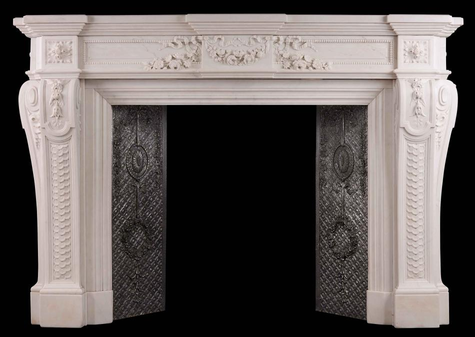 A very finely carved French Louis XVI Style Statuary Marble Fireplace