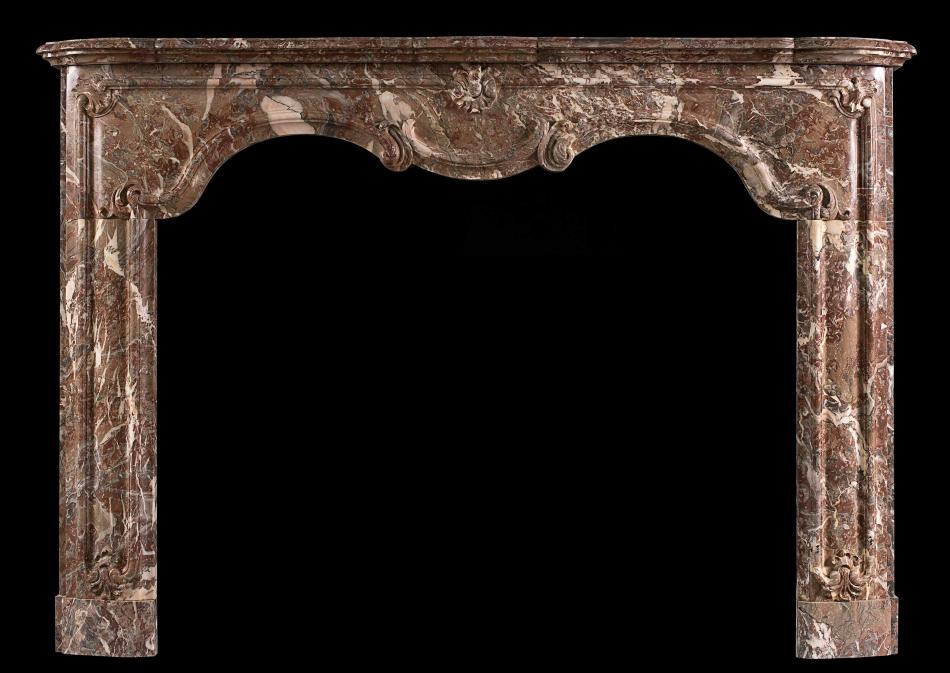 A period 18th century Louis XIV/XV transitional fireplace in Languedoc marble