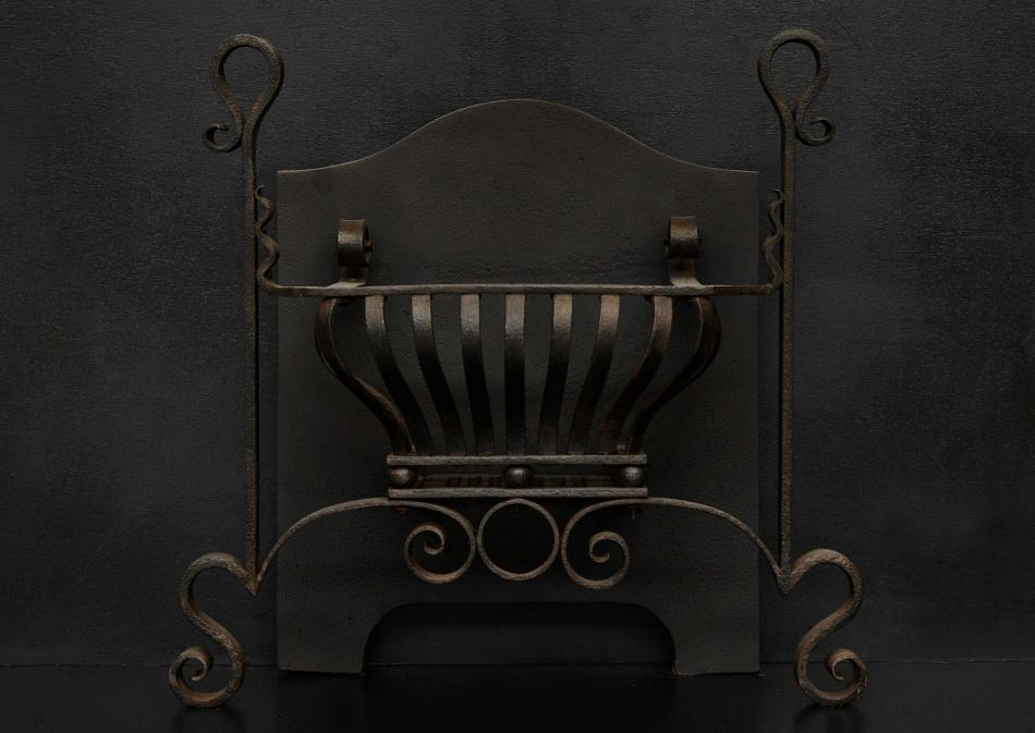 An Art Nouveau firegrate of scrolled form