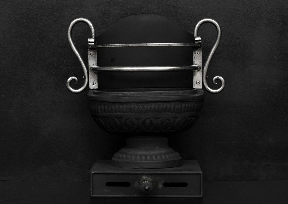 A Regency style cast iron urn grate