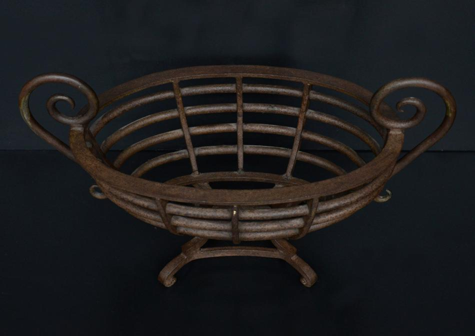 A wrought iron oval firegrate