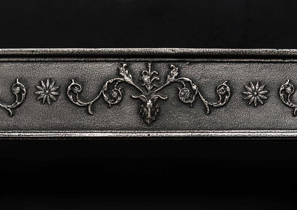 An English Regency polished cast iron register grate