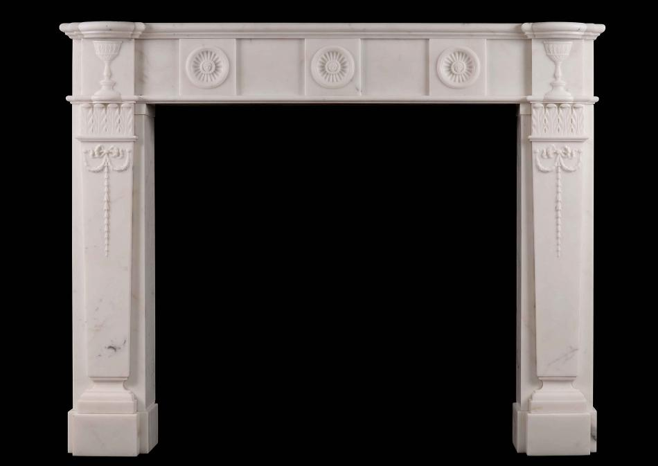 An English Regency style antique fireplace in Statuary marble
