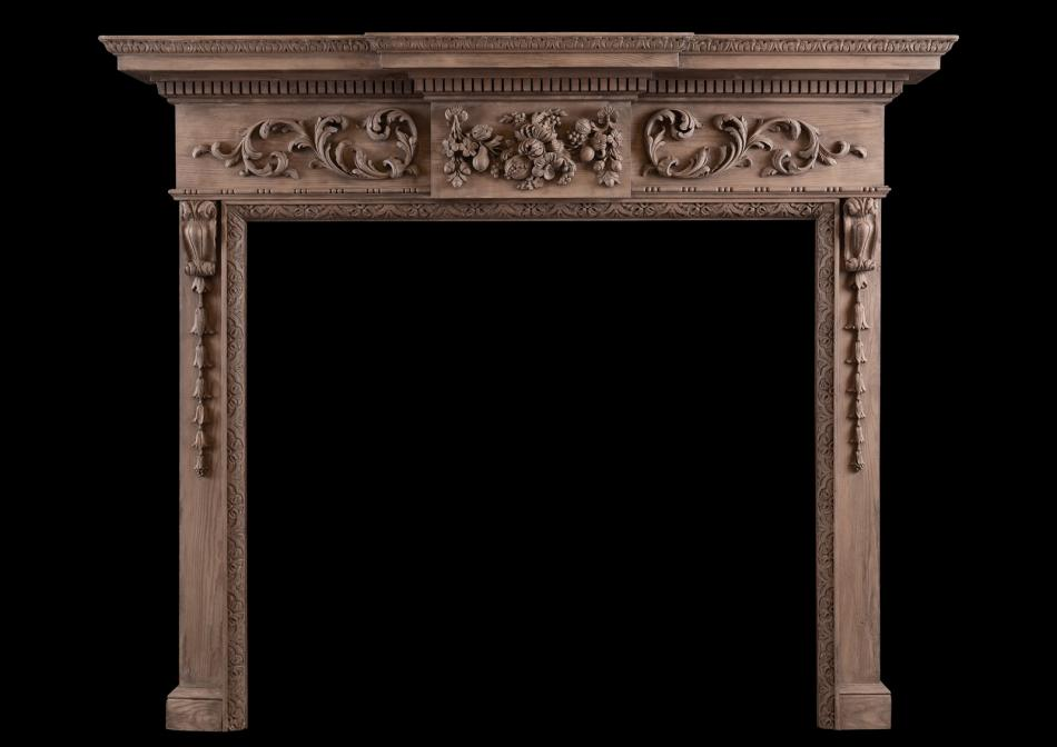 A carved English pine fireplace