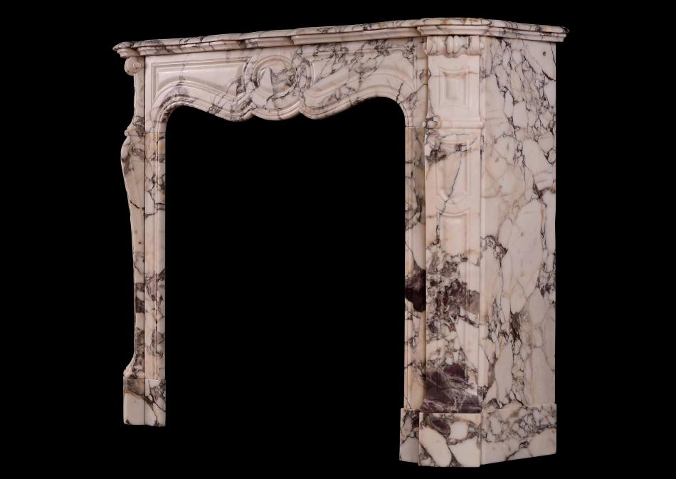 A 19th century French antique fireplace in Breche Violette marble
