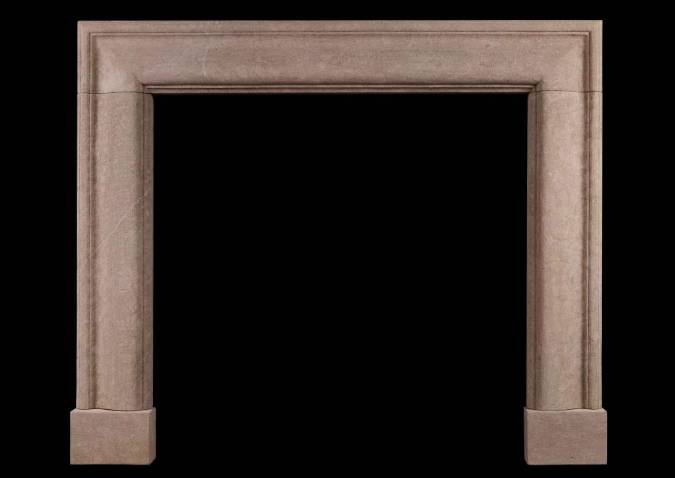 An English moulded bolection fireplace in Bath stone