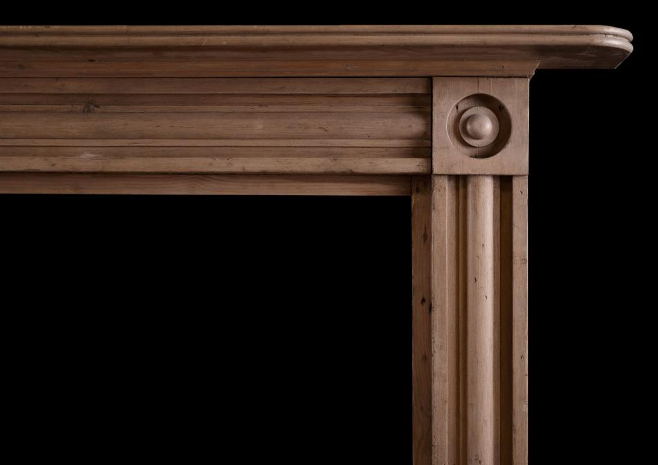 A Regency style carved wood fireplace
