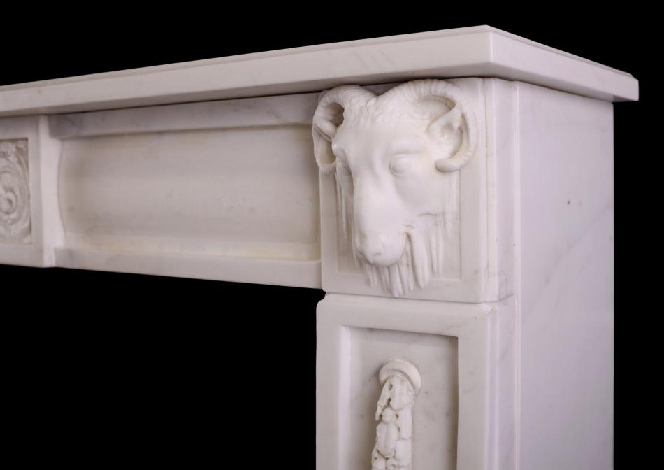 An Italian Statuario marble fireplace with carved rams heads
