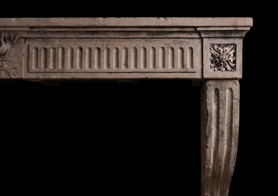 A period Louis XVI carved limestone fireplace