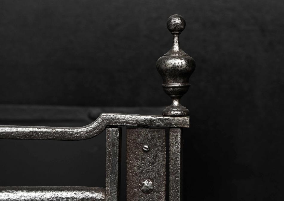A period 18th century polished steel firegrate