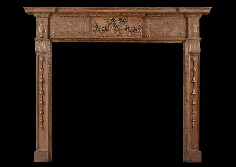 An English pine and gesso antique fireplace