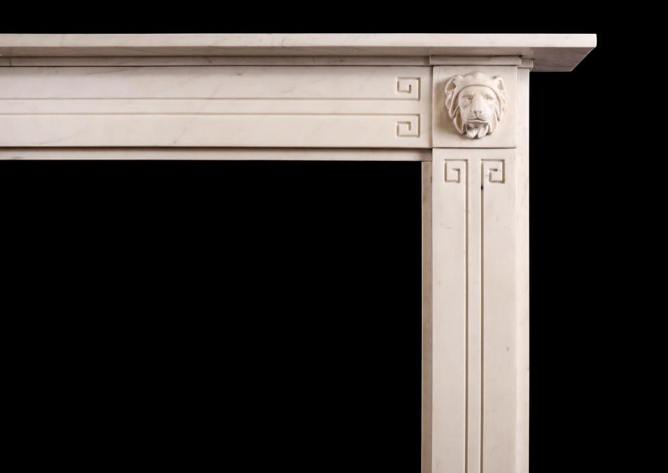 A fine quality white marble Regency fireplace with carved lions to end blockings