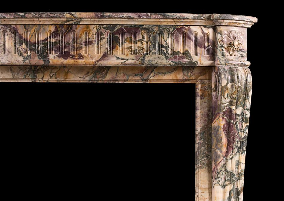 A Louis XVI style antique fireplace in Breche de Benou marble