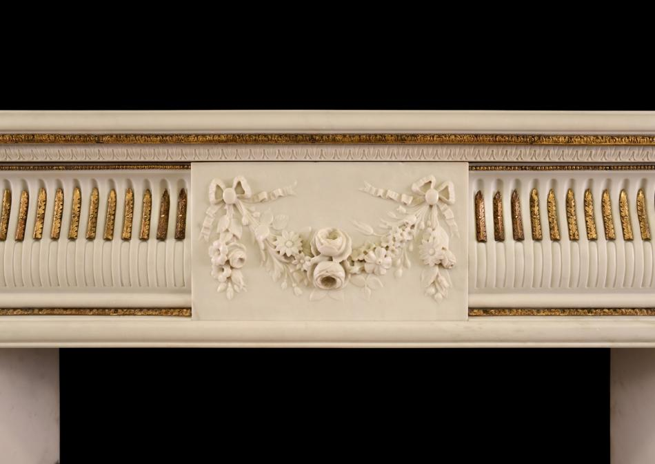 An English Regency Statuary marble fireplace with inlaid brass ormolu