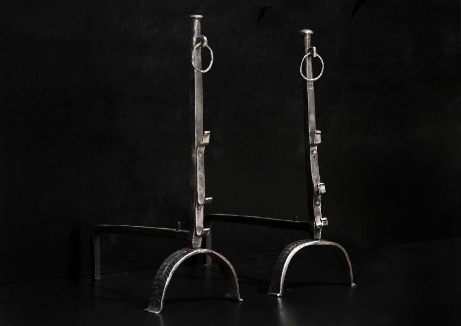 A large pair of polished wrought iron firedogs 32.5 inch