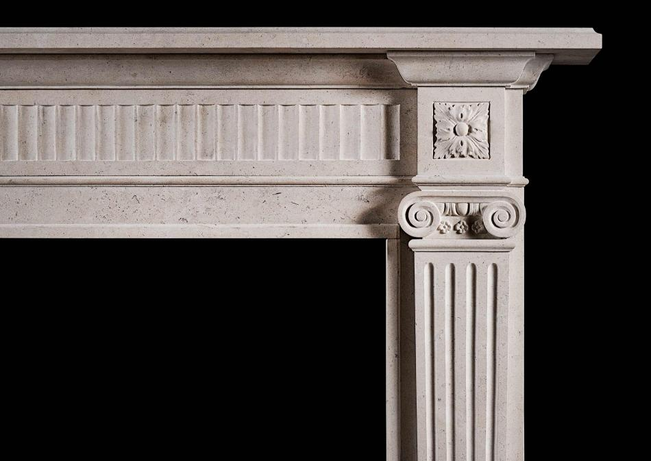 An elegant Georgian style limestone fireplace