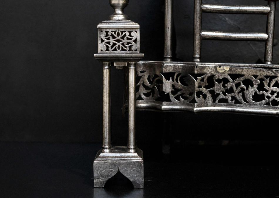 A period, mid Georgian steel firegrate in the manner of Thomas Chippendale