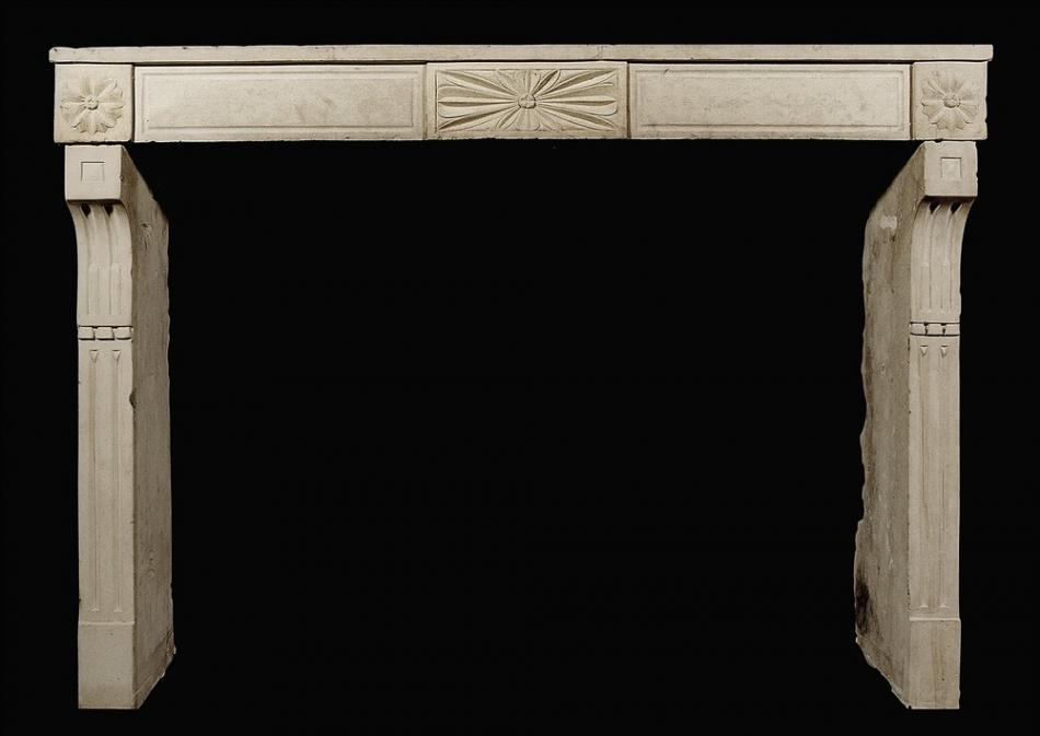 A rustic 18th century French Louis XVI stone fireplace