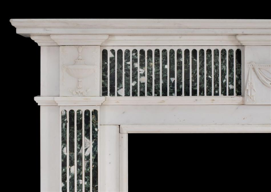 A George III style English Statuary marble fireplace with inlaid Tinos marble