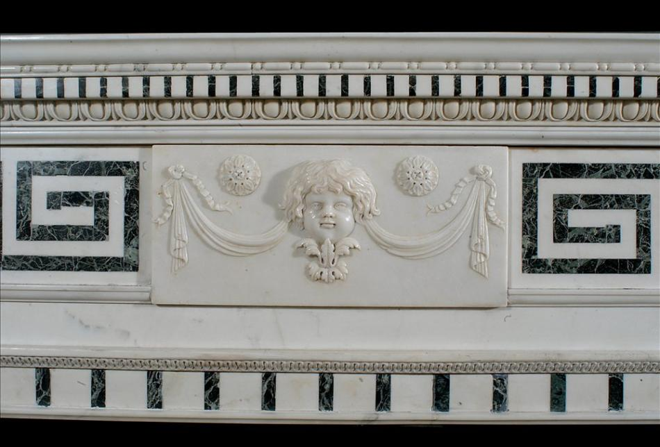 A 19th century English Statuary and inlaid Tinos marble fireplace