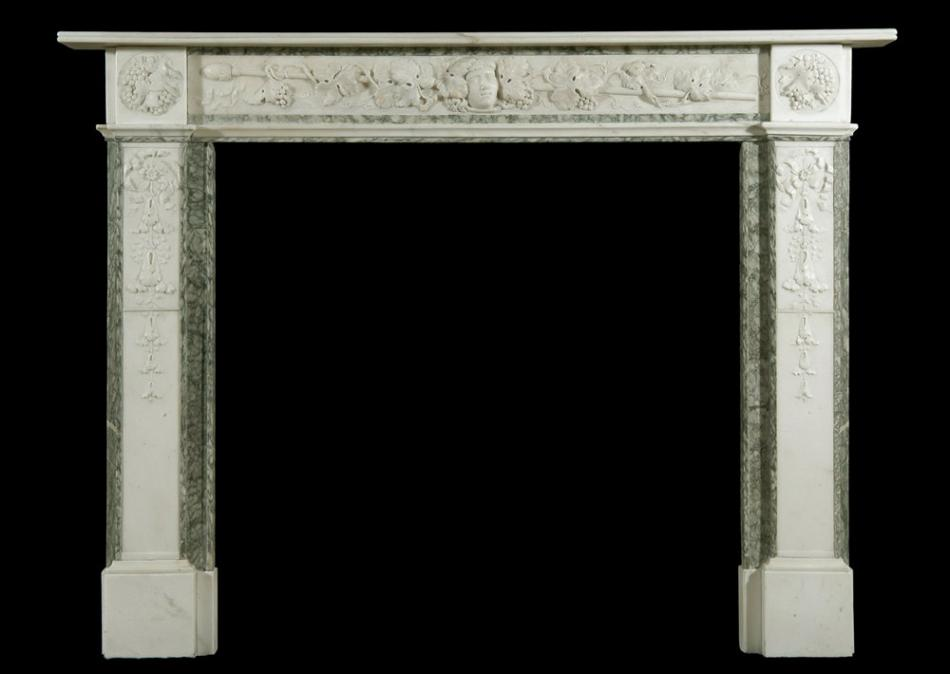 A 19th century English Statuary and Vert d'Estours marble fireplace