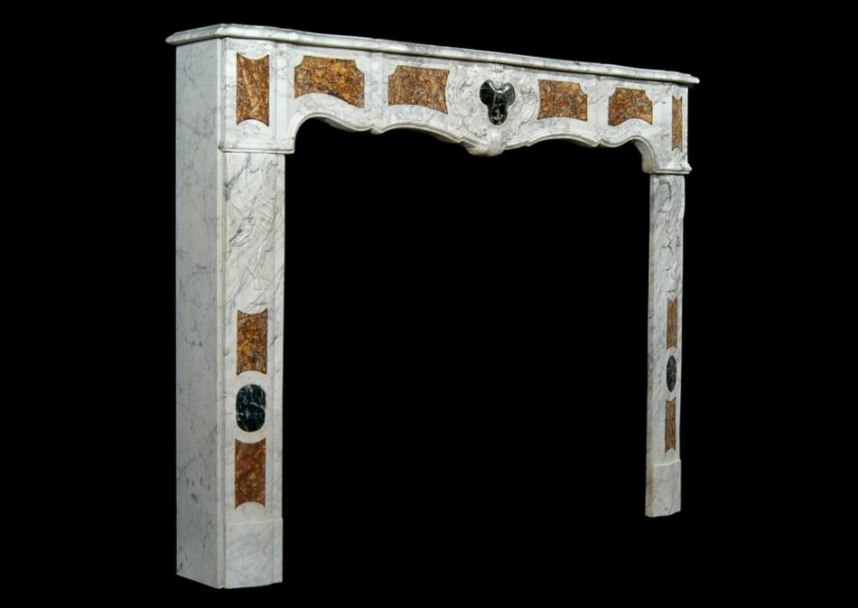 An 18th century French Provençal Carrara marble fireplace
