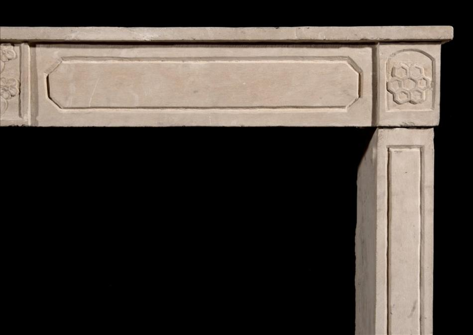 An early 19th century French Empire limestone fireplace
