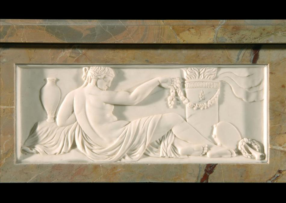 A Sarrancolin French Louis XVI style marble fireplace