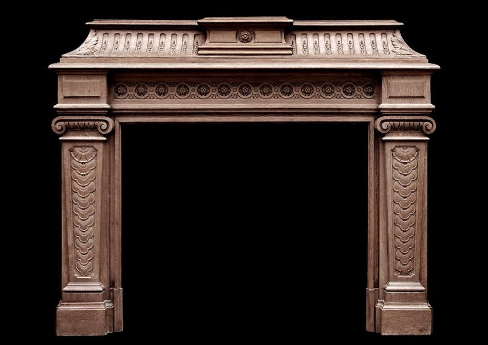 A 19th century antique French oak fireplace