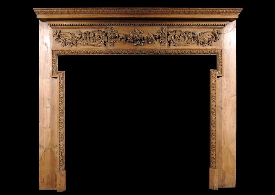 A 19th century George III style pine chimneypiece