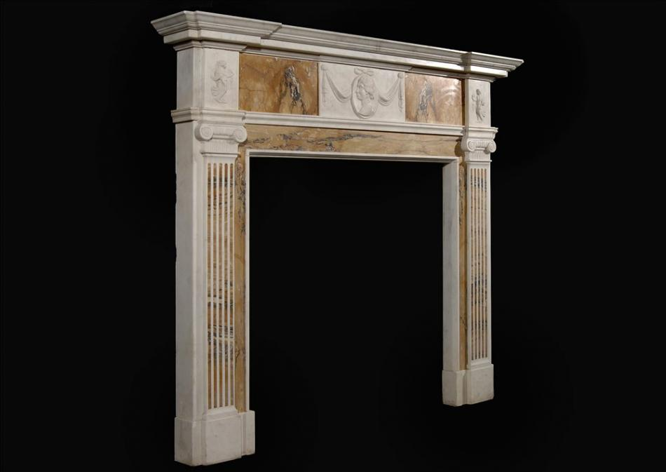 An English George III style Statuary and inlaid Sienna fireplace