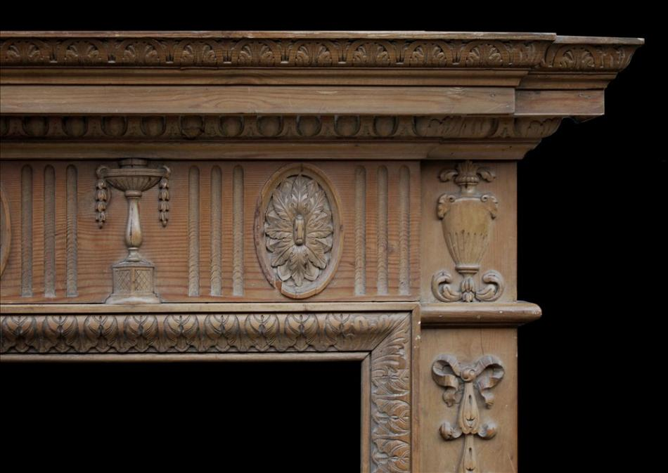 A classical English waxed pine fireplace