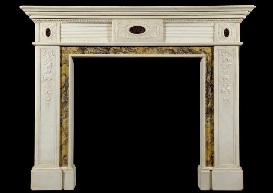 A Regency style Statuary marble chimneypiece inlaid with porphyry