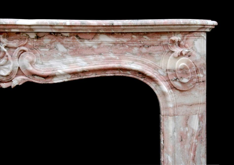 An Antique French Louis XV style fireplace in Norwegian Rose marble