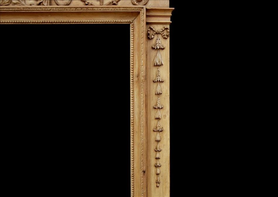 An attractive 18th century George III pine fireplace