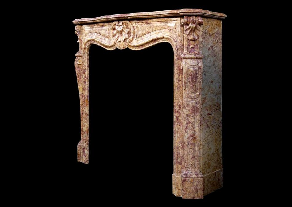 A French Louis XV style fireplace in Spanish Brocatelle marble