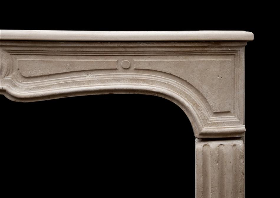 An unusual 18th century French limestone fireplace
