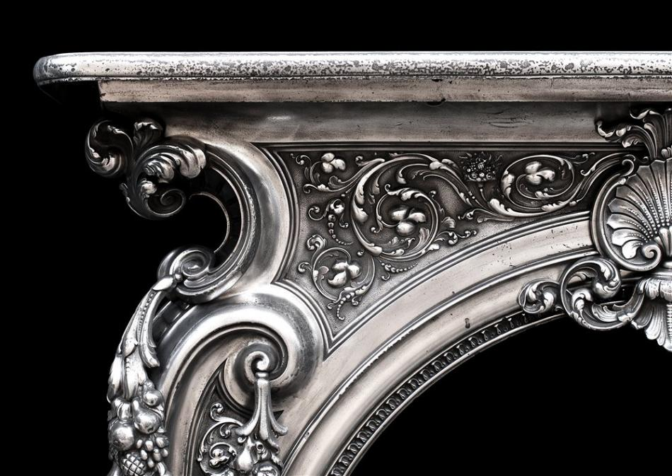 An ornate 19th century French cast iron fireplace