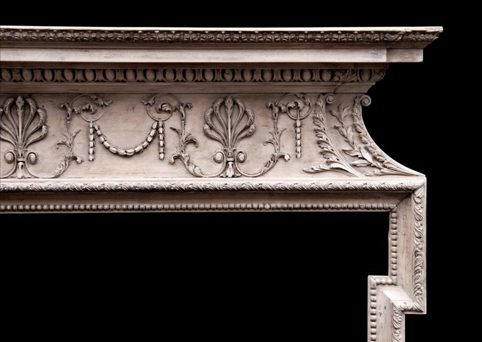 A delicate 18th century English pine fireplace