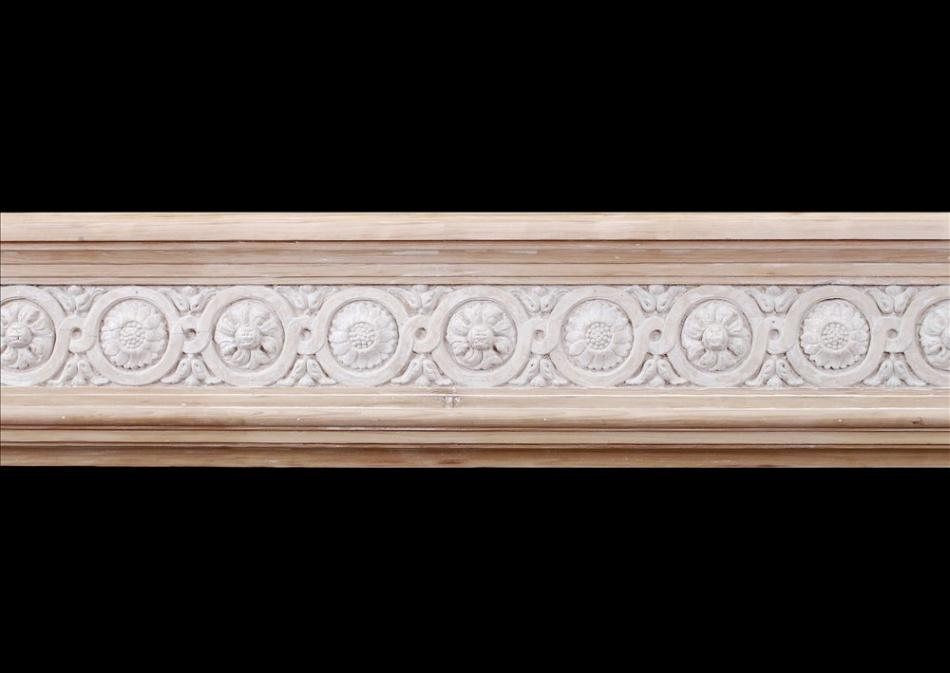 A French Louis XVI style wood fireplace with composition enrichments